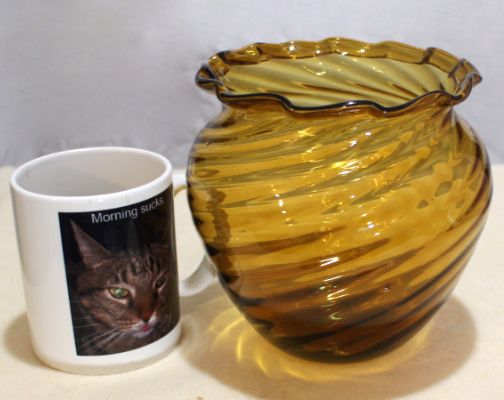 Amber glass vase, ribbed swirl, folded rim