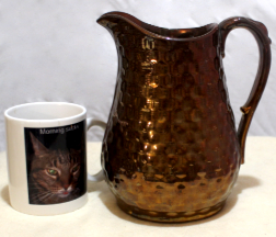 Pitcher with copper luster glaze
